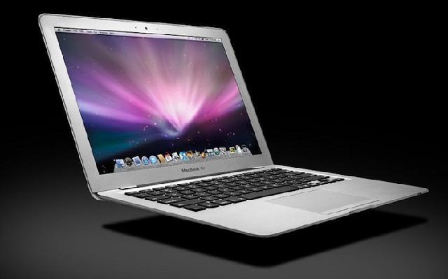 为什么黑色的苹果笔记本电脑要比白色的贵150美元.图片